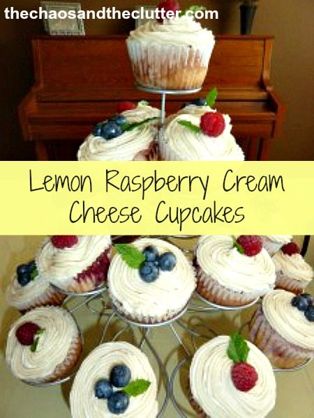 lemon raspberry cream cheese cupcakes topped with buttercream, fruit and mint leaves